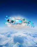 Composite image of laptop on floating cloud with apps Royalty Free Stock Image