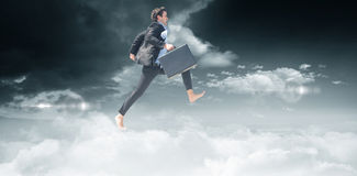 Composite image of leaping businessman Stock Images