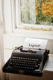 Composite image of legend! message. Legend! message  against typewriter on a table Stock Photography