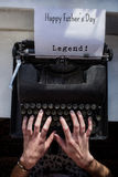Composite image of legend! message. Legend! message against womans hand typing on typewriter royalty free stock photos