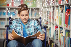 Composite image of letters. Letters against disabled schoolboy reading book in library Royalty Free Stock Photos
