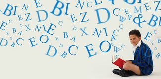 Composite image of letters. Letters against schoolboy reading book on white background Royalty Free Stock Photography