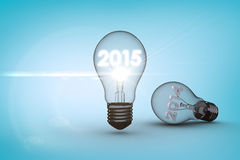 Composite image of 2014 and 2015 in light bulb Stock Image