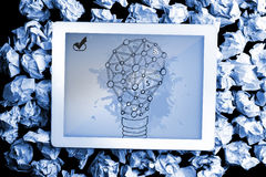 Composite image of light bulb on paint splashes Stock Images