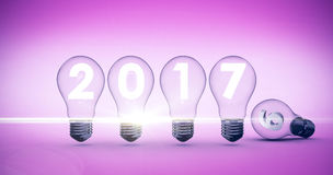 Composite image of light bulbs with 2017 over white background. Light bulbs with 2017 over white background against pink Royalty Free Stock Image