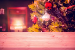 Composite image of a light parquet. A light parquet against wrapped gifts near a christmas tree Stock Photo