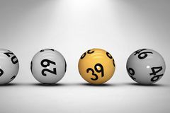 Composite image of line of lottery balls. Line of lottery balls against grey background Royalty Free Stock Photo