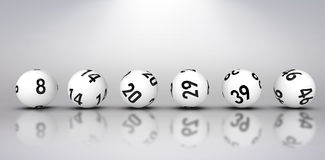 Composite image of line of lottery balls. Line of lottery balls against grey background Stock Images