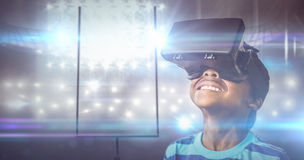 Composite image of little boy holding virtual glasses and looking away Royalty Free Stock Photo
