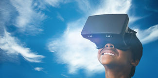 Composite image of little boy holding virtual glasses and looking away Royalty Free Stock Image