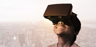 Composite image of little boy holding virtual glasses and looking away Royalty Free Stock Images