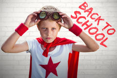 Composite image of little boy pretending to be superhero Royalty Free Stock Photo