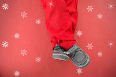 Composite image of little boys legs in santa costume Stock Photography