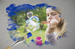 Composite image of little girl blowing bubbles Royalty Free Stock Photo