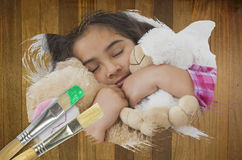 Composite image of little girl cuddling teddys Stock Images