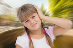 Composite image of little girl with headache Royalty Free Stock Images