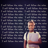 Composite image of little girl holding folders in school corridor Royalty Free Stock Photos
