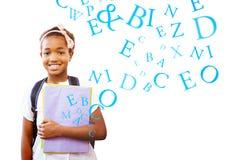 Composite image of little girl holding folders in school corridor Stock Photos