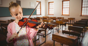 Composite image of little girl playing violin Stock Image