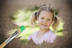 Composite image of little girl smiling in the park Stock Photography