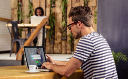 Composite image of login with smiling glasses woman and pad Stock Photos