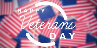 Composite image of logo for veterans day in america. Logo for veterans day in america  against directly above shot of small national flags Stock Photo