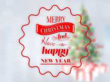 Composite image of  logo wishing a merry christmas Royalty Free Stock Photography