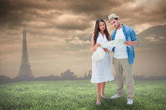 Composite image of lost hipster couple looking at map Stock Image