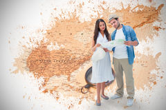 Composite image of lost hipster couple looking at map Royalty Free Stock Photos