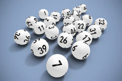 Composite image of lottery balls. Lottery balls against grey background Stock Photo