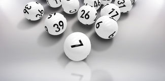 Composite image of lottery balls. Lottery balls against grey background Royalty Free Stock Photo