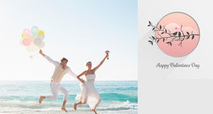 Composite image of love birds. Love birds against newlyweds having fun holding balloons Stock Images