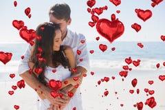 Composite image of loving couple cuddling Stock Photo