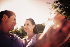 Composite image of loving and happy couple dancing at park royalty free stock photos