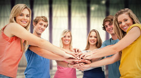 Composite image of low angle shot of friends smiling and looking at the camera Stock Photography