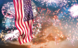 Composite image of low angle view of american flag. Low angle view of American flag against colourful fireworks exploding on black background Royalty Free Stock Photography