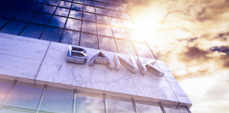 Composite image of low angle view of bank text building. 3d Low angle view of bank text building against view of blue sky and cloud Stock Image