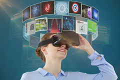 Composite image of low angle view of businesswoman using virtual reality headset 3d royalty free stock photo
