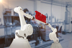 Composite image of low angle view of white robotic hand holding team work text Royalty Free Stock Photography