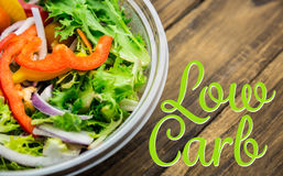 Composite image of low carb. Low carb against healthy bowl of salad on table stock photos