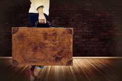 Composite image of low section of woman holding vintage suitcase Stock Photography