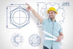 Composite image of male architect with blueprints pointing away Royalty Free Stock Images