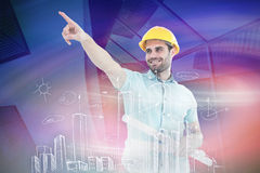 Composite image of male architect with blueprints pointing away Royalty Free Stock Photos