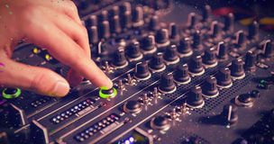 Composite image of male dj playing music Stock Images