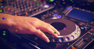 Composite image of male dj playing music Royalty Free Stock Photos