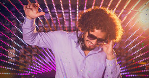Composite image of male dj playing music Stock Photo