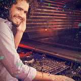 Composite image of male dj playing music Royalty Free Stock Photo