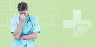 Composite image of male doctor suffering from headache. Male doctor suffering from headache against green background Stock Photography