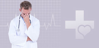 Composite image of male doctor suffering from headache. Male doctor suffering from headache against green background Royalty Free Stock Photography
