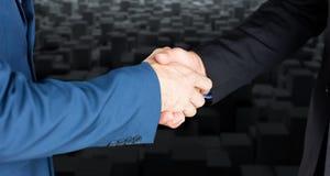 Composite image of male executives shaking hands. Male executives shaking hands against computer graphic image of black blocks stock image